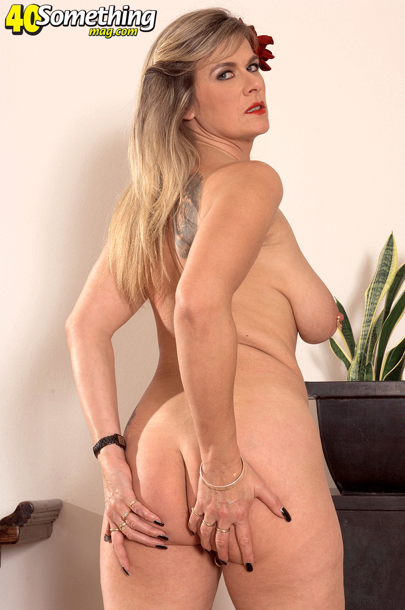 ... clips and pics of gorgeous German big tit pierced milf Marina Rene