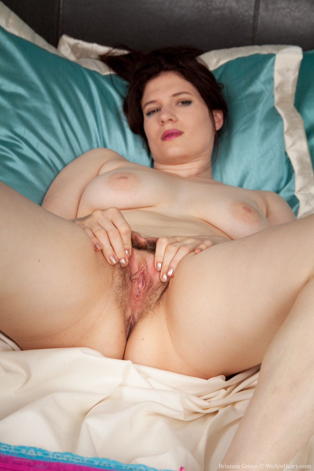 image Zia loves being hairy and fingering her pussy